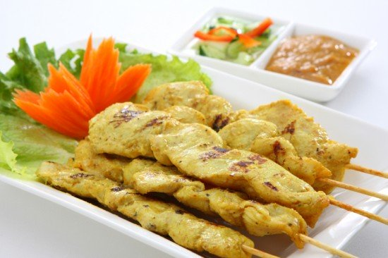 Chicken satay with peanut dipping sauce and cucumber relish
