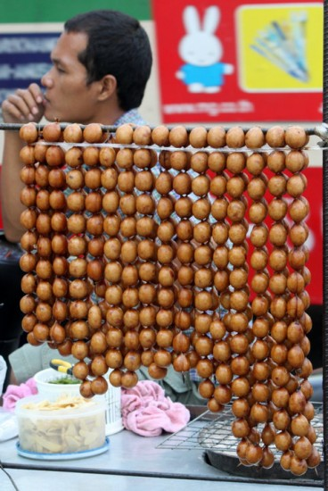 Thai Sausage Balls in Long Links on a Busy Bangkok Street