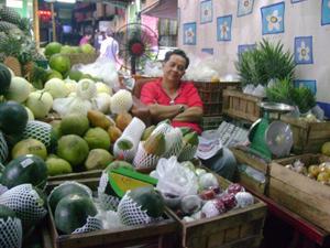 Smiling Thai Fruit Vendor